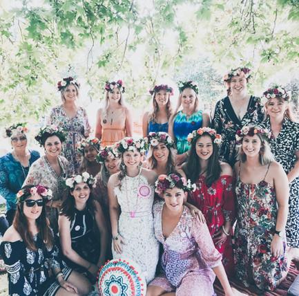 group of women wearing flower crowns