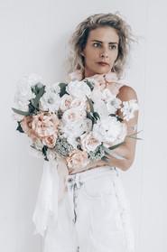 florsit holding wedding bouquet