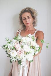 florsit holding bouquet of bridal flowers