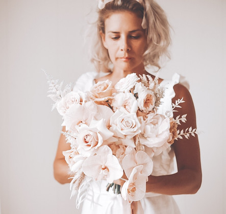 wedding florst holding bridal bouquet in