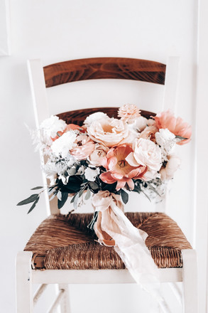 bridal bouquet with peonies on chair