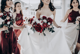 bride and her bridesmaids holding beautiful peony bouquets