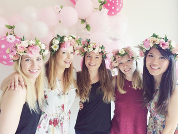 hens party girls wearing flower crowns in front of balloons