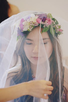 bride wearing veil and flower crown