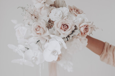 phalenopsis orchids and quicksand roses wedding bouquet