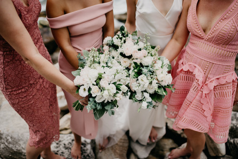 bridesmaids holding floral bouquets on wedding day