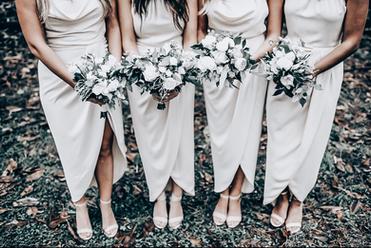 bridesmaids holding white flowers
