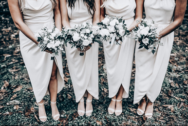 bridesmaids holding white flowers