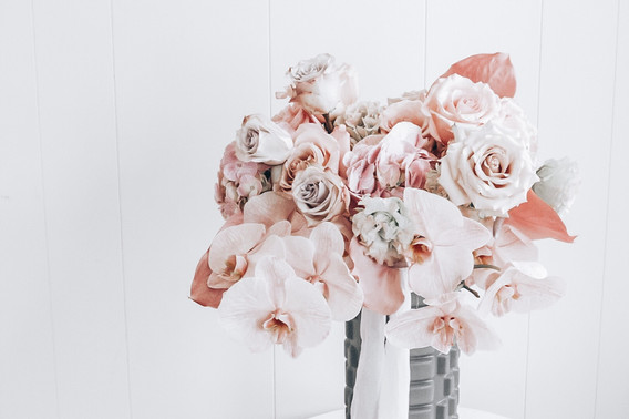 wedding bouquet of orchids and premium roses