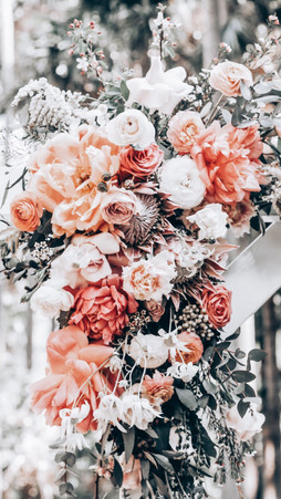 peonies and proteas on wedding arbor at Palm Beach