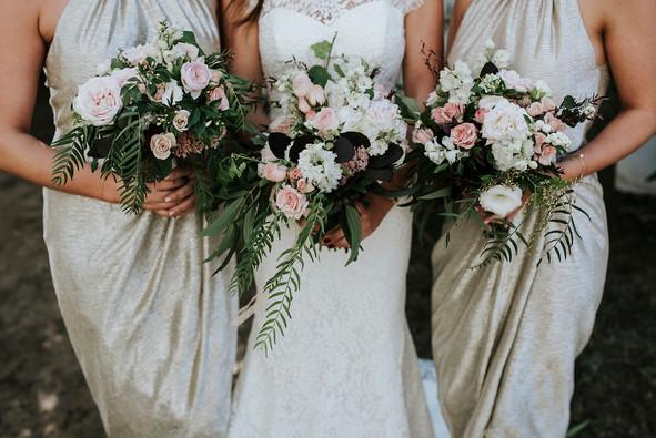 wedding bouquets held by bride and bridesmaid