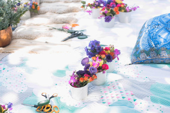 picnic with buckets of bright flowers