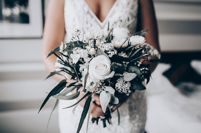 wedding bouquet of white roses and native flowers