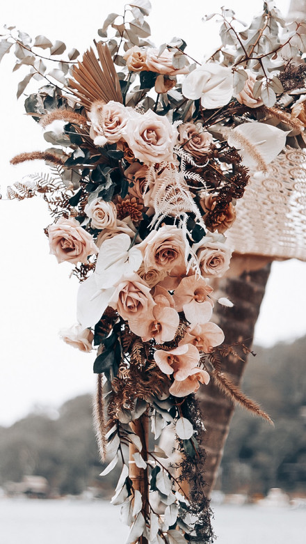 nude and blush earthy arch flowers