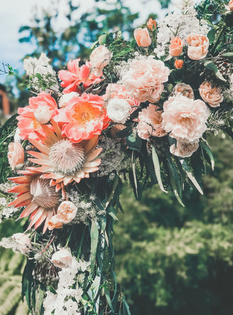peonies and proteas in wedding arch at gunners barracks