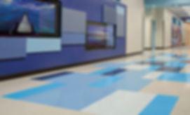 Piso de vinil compuesto VCT Azrock tonos cremas y azules