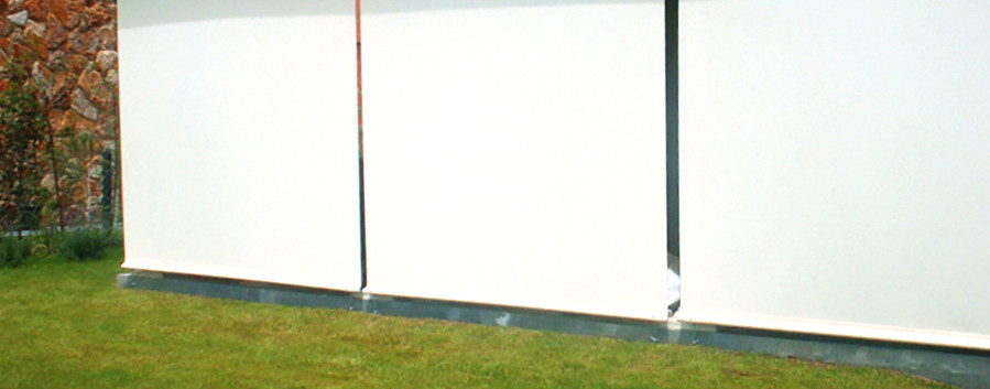 Cortinas perma de exterior en terraza blancas