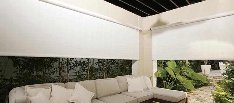 Cortinas enrollables de exterior en terraza residencial
