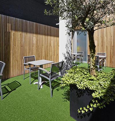 Grama artificial Spring en patio