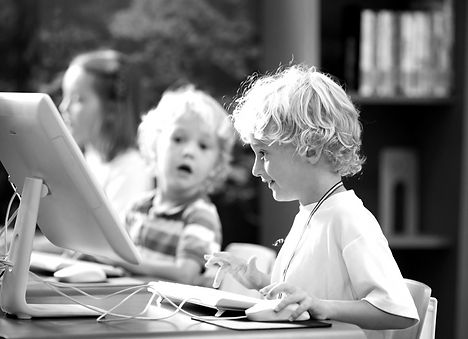 Kids with computer. Children learning an