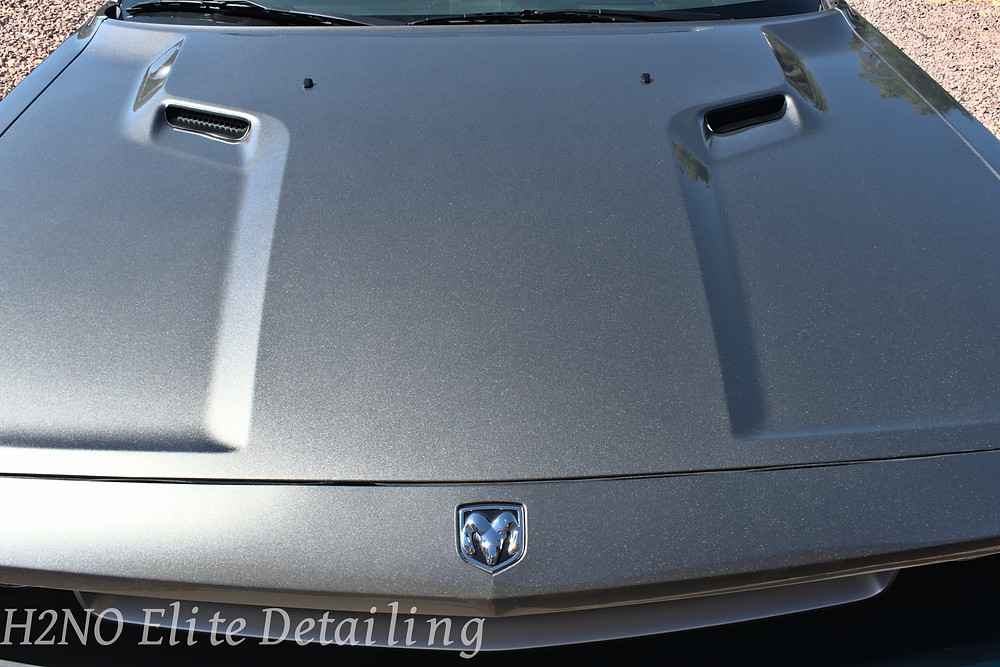 Ceramic coated and paint corrected hood of dodge challenger