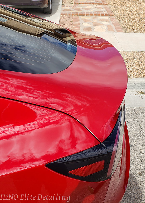 Trunk of paint correction and ceramic coating red Tesla Model 3 in El Paso TX