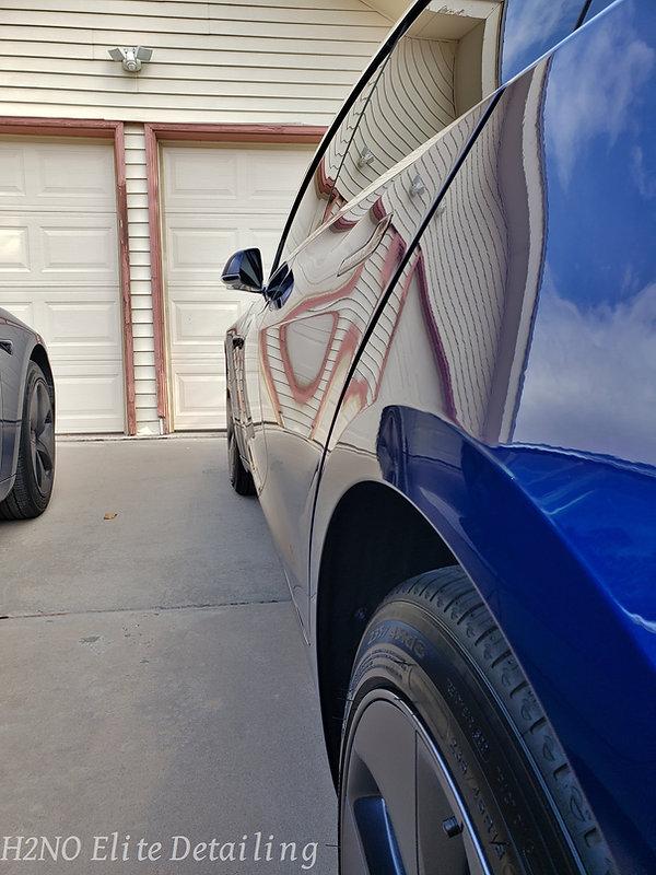 Mirror finish of Ceramic Coating blue Tesla Model 3