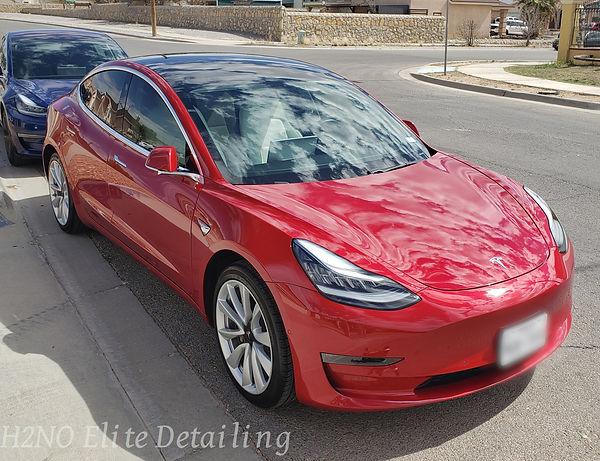 Passenger corner angle of red Tesla model 3 ceramic coating in El Paso TX
