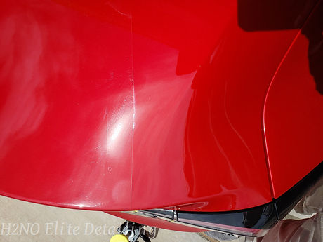 Paint Correction on a red Tesla Model 3 in El Paso TX