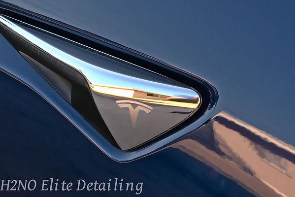 Mirror finish on blue Tesla Model 3