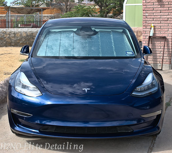 Blue Tesla Front Ceramic Coating Reflection