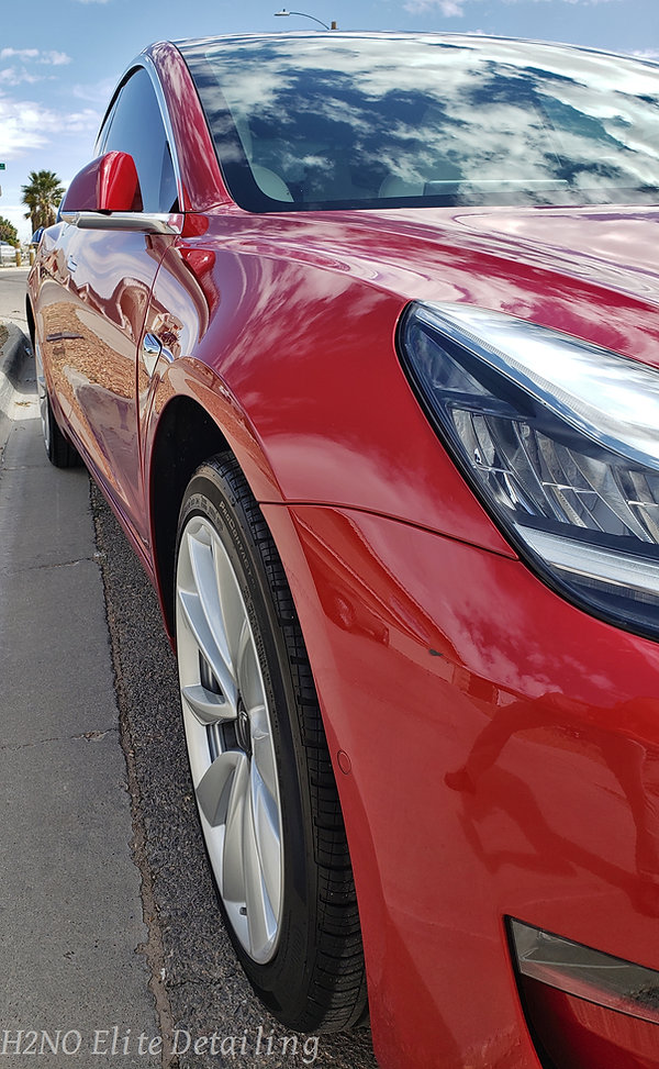 Front Wheel Red Tesla Model 3