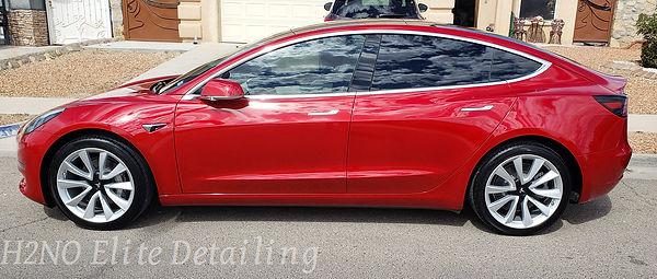 Driver side view of ceramic coating red tesla model 3