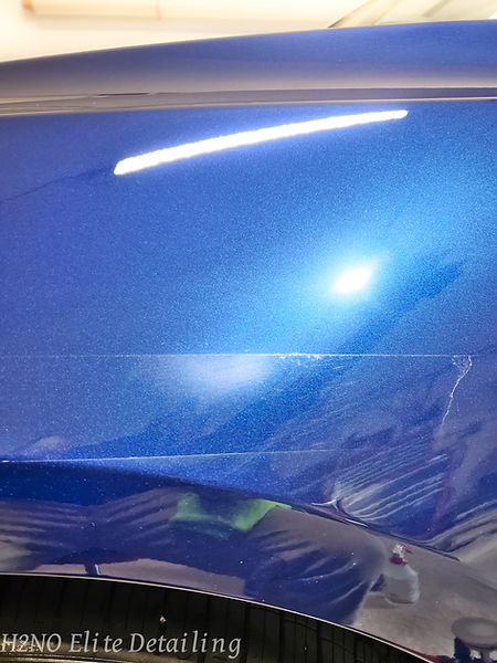 Paint Correction on a blemish of a blue Tesla Model 3 in El Paso TX