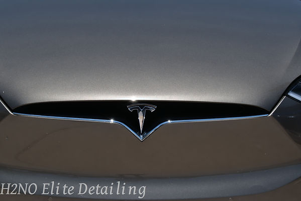 Tesla Emblem Paint Correction Front in El Paso
