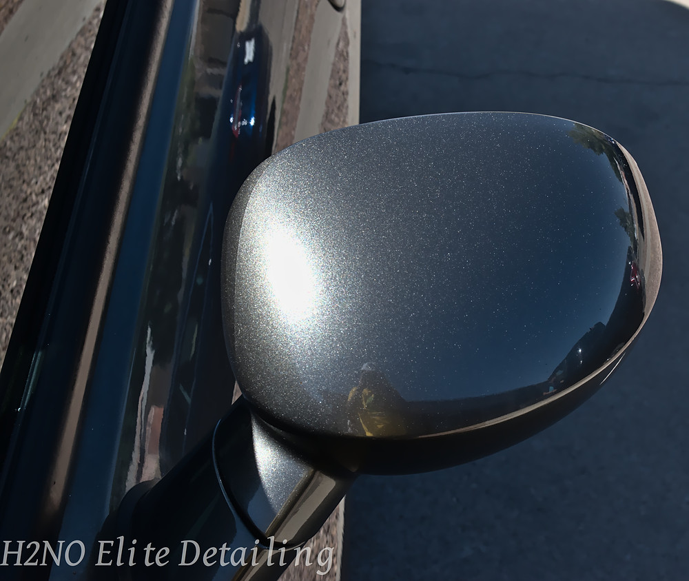 Polished side mirror of dodge challenger in El paso