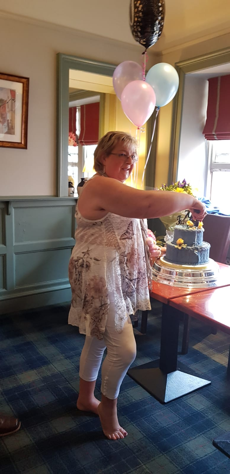 Surprise 70th cake cutting