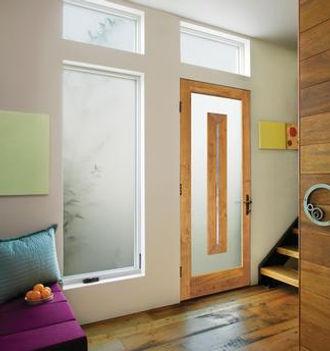 wood door and three windows