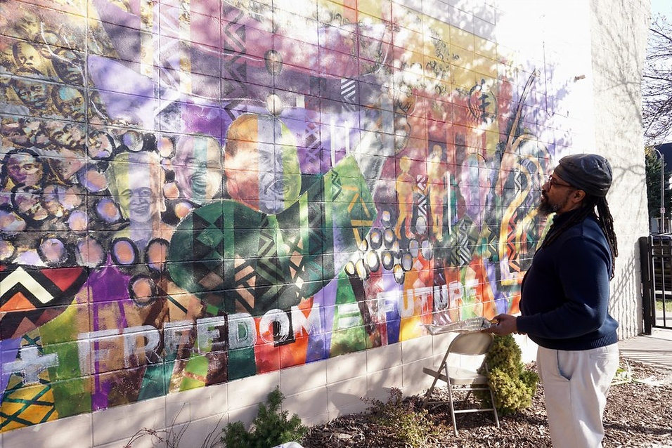 House of Peace Mural Gets Restored2.jpg