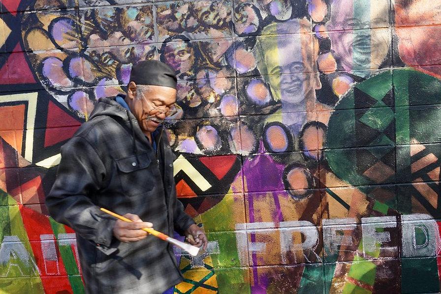 House of Peace Mural Gets Restored1.jpg