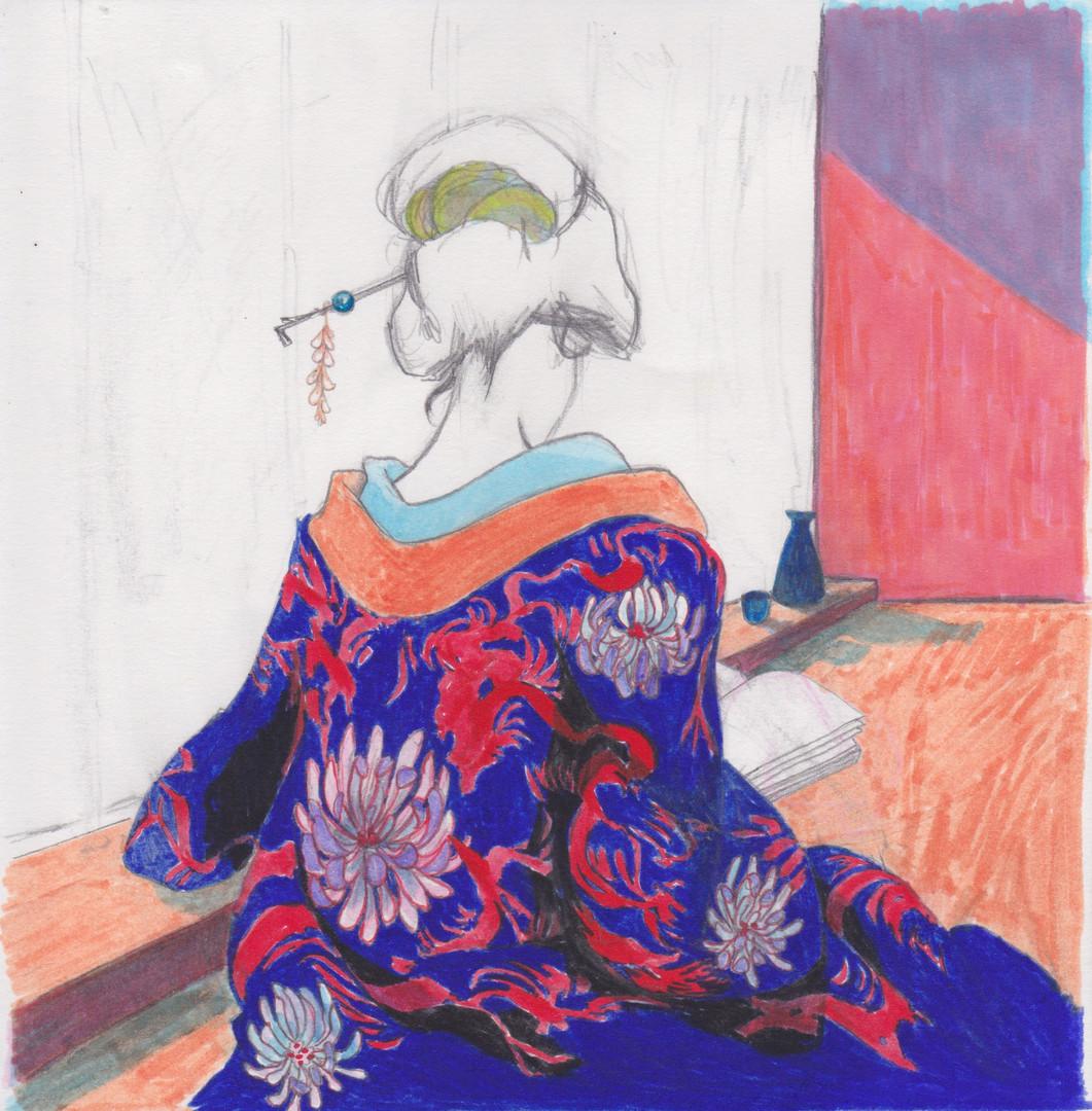 Girl in kimono reading a book