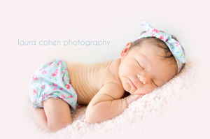 newborn girl with flower bloomers