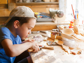 boy learning wood carving-sm.jpg