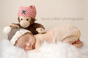 newborn with a monkey