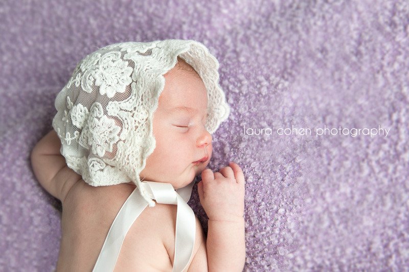 newborn girl with a vintage bonnet