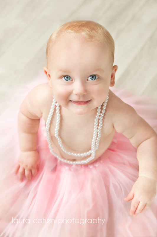 girl first birthday with pearls and pink tutu