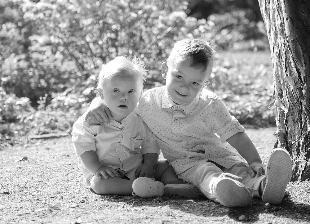 two boys hugging, black and white