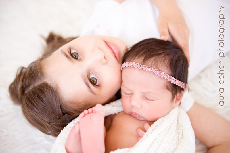 newborn girl and sister