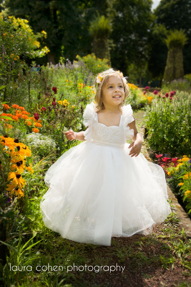 little girl on a flower path