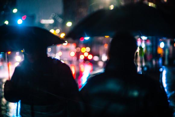 Men with umbrellas